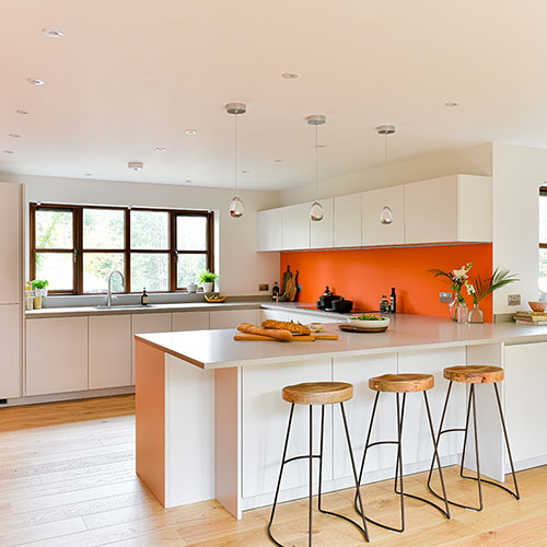 Fresh orange, white and wood kitchen